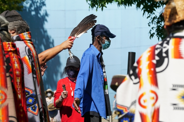 10 years after the police killing of John T. Williams, Native Americans gather under the totem pole carved in his memory at Seattle Center. Photos by Susan Fried