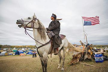 Frank Archambault rides security for the main camp, called Oceti Sakowin, on the Standing Rock reservation. Photo by Alex Garland