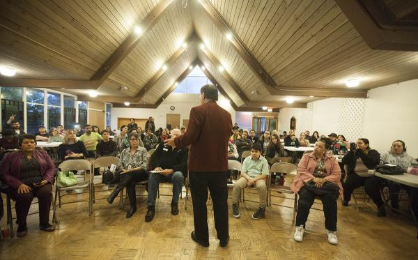 Community members gather at St. Matthew Episcopal Church with city leaders March 21 to discuss a plan to make Auburn an inclusive or sanctuary city. Photo by Ngoc Tran