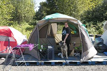 Alisa Christopher and her dog live in Camp Second Chance on Myers Way in West Seattle.
