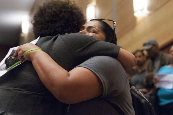 Roxanne, a member of the First Nations tribe, hugs Lorna Murray, Charleena's neighbor. Photo by Monica Westlake