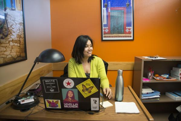 Legal advocate Norma Gonzalez works at Colectiva Legal del Pueblo's small office in Burien, a town of 50,000 in South King County. Photo by Sarah Shannon
