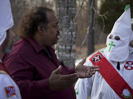 Anti-racist activist Daryl Davis talks with a Klan member at a rally in Missouri. Photo courtesy of Daryl Davis
