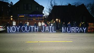 Dozens demonstrated outside of Mayor Ed Murray's house to resist the approval of a new youth jail that King County plans to build in 2017. Photo by Ashley Archibald