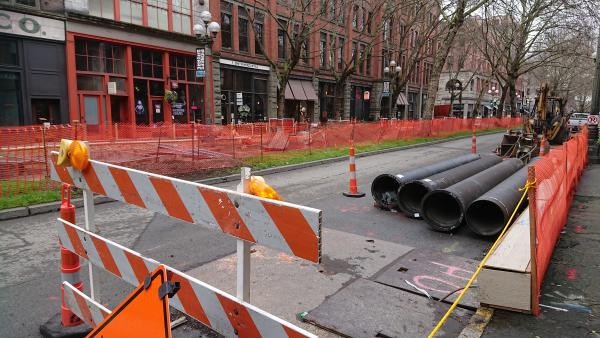 Construction on First Avenue between S. Washington and S. Main Street. Mayor Durkan placed a hold on the City Center Connector streetcar project. Photo by Lisa Edge