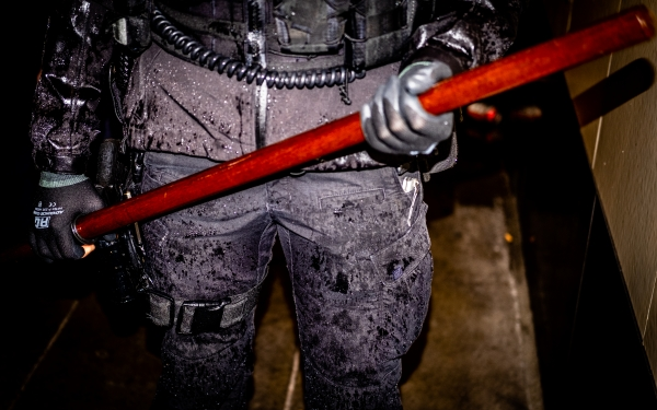 A Seattle police officer brandishes his night stick during a May 30 George Floyd protest.