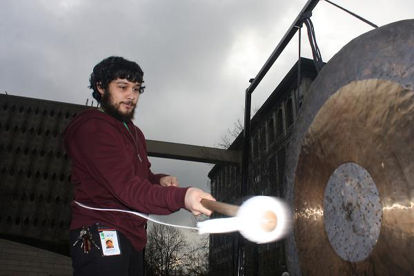 Downtown Emergency Service Center's Thomas Kravitz bangs the gong in front of City Hall on Jan. 26 to awaken those inside to the plight of unsheltered homeless people. Photo by Jon Williams, Real Change