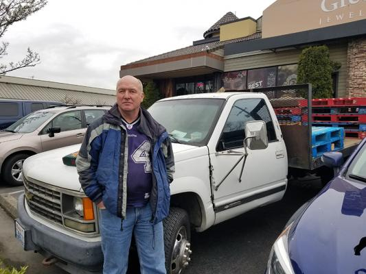 Holton Miller is one of thousands of people in Seattle that has had their vehicle towed. It was his only form of shelter. Photo by Ashley Archibald