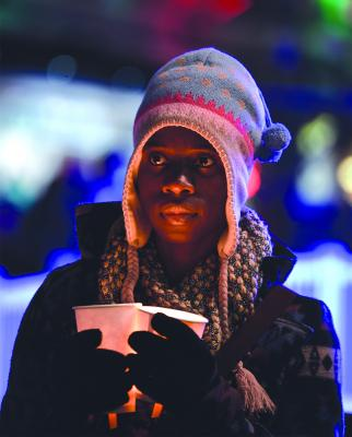 Micheline Lubin participated in the Women in Black Candlelight Vigil which began at sundown Dec. 21 at Victor Steinbrueck Park. They silently marched to Westlake Park. Photo by Valerie Franc-Houge