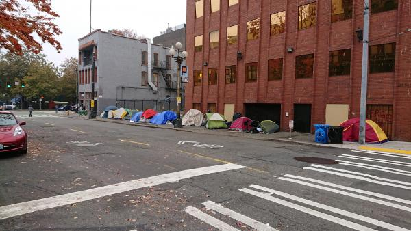 Tents line a portion of S. Washington Street in Pioneer Square.