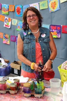 Susan Russell around her art. Real Change file photo