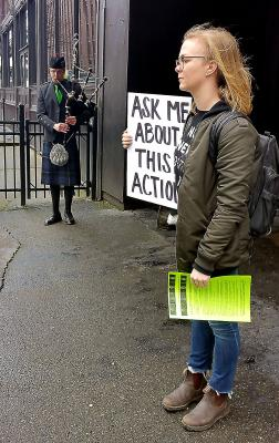 Natalie Evans protests with European Dissent outside of an event where Mayor Ed Murray was speaking to kick off Irish Week. The group is protesting the new youth detention facility. Photo by Ashley Archibald