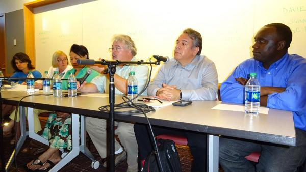 Members of the press answer questions from South King County community members. Photo by Lisa Edge