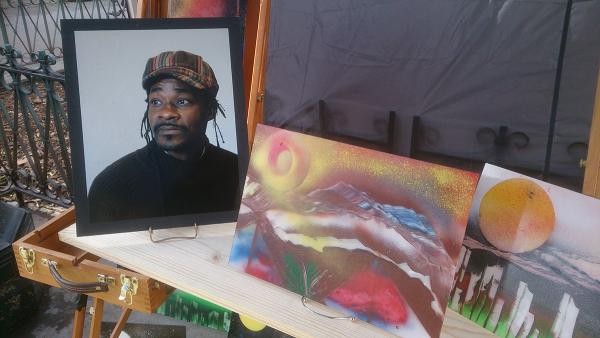 A portrait of Ewing sits next to some of his art at the memorial. Photo by Lisa Edge