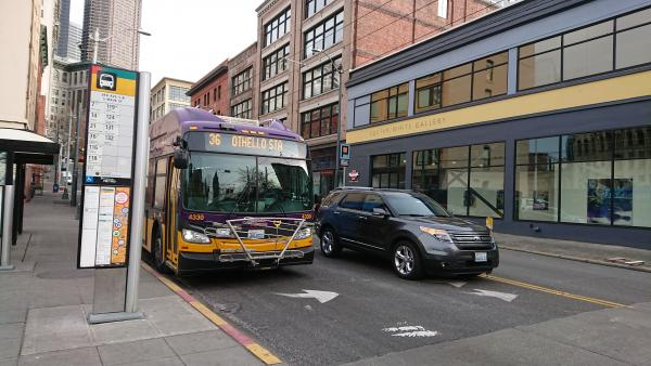 A King County metro bus stops at a busy location in Pioneer Square. Photo by Lisa Edge