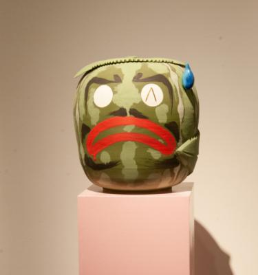 """Anxious Watermelon"" by Alex Anderson, stoneware, glaze and gold luster on wood pedestal, 15x12x14. Photo by Walter Tuai"