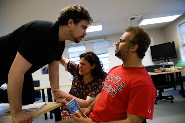This scene from a rehearsal, shows a strain in the relationship between Lloyd (Marco Adiak Voli, left), May ( Monica Cortés Viharo, center) and Henry (Fernando Cavallo). Photo by Matthew S. Browning