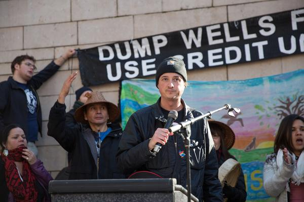 Matt Remle speaks at a divestment rally. Photos by Alex Garland