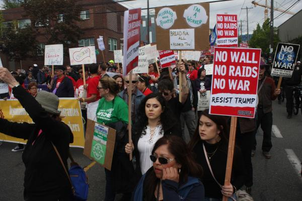 Cynthia Ruiz and Alissica Cortes march down Jackson Street during Tuesday's March for Immigrant and Workers Rights, above. Photo by Jon Williams