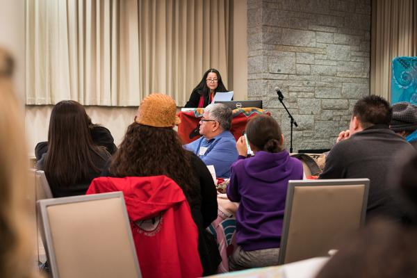 Mother Nation Founder and CEO Norine Hill speaks at Seattle University in April. Photo by Rob Bibelhauser