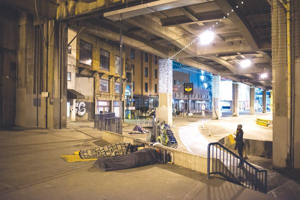 Many people in Seattle sleep without a roof over their heads every night but Seattle's homeless population settle for a viaduct. Photo by Andrew Waits