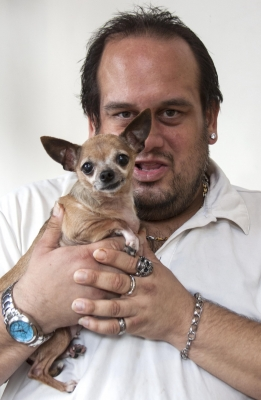 Real Change vendor Joshua Trujillo lost his dog Bella during a hospital stay. He was lucky to get her back.