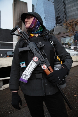 A member of the John Brown Gun Club stands on Cherry Street supporting a counter protest against a rally held by a right-wing militia group.