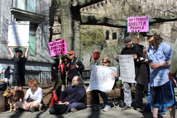 SHARE supporters rallied in front of the King County Courthouse on March 31 for funds to keep its Seattle shelters open.