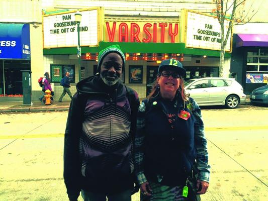 Tracey Williams and Susan Russell stand outside the Varsity Theatre in Seattle's University District.