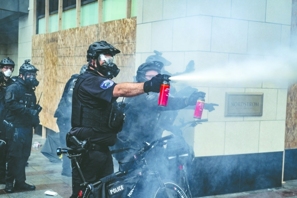 Police launch pepper spray and tear gas at protesters who writhed and doused their faces with milk to ease the pain. Anecdotes, including firsthand reports and social media posts, placed the blame on police; city officials said protesters started the viol