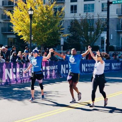 Lamarr, a member of RunningWorks, finishing his third consecutive Charlotte marathon and celebrating a personal record. Courtesy of RunningWorks