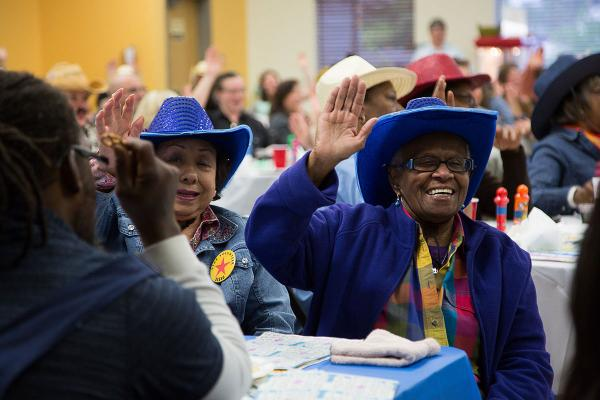 Seniors play bingo at Western-themed Rainbow Bingo at the Southeast Seattle Senior Center. Rainbow Bingo is a big fundraiser for the center. Photo by Elizabeth Ogle