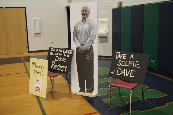 Covington activists hold an open seat for absent U.S. Rep. Dave Reichert in protest for his absence in recent town hall events in his district. Photo by Bernard Ellouk