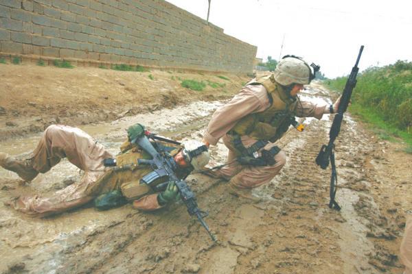 Sgt. Jesse E. Leach drags Lance Cpl. Juan Valdez to safety
