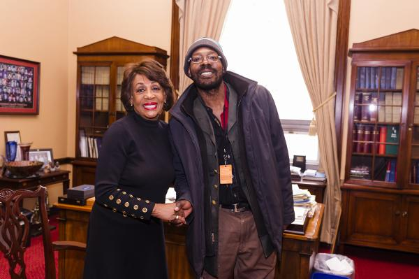 United States Representative Maxine Waters with Street Sense Media vendor Reginald Black. Photo by Rodney Choice