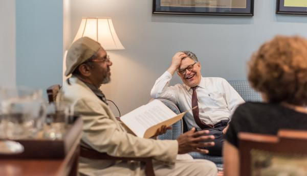 Vendor Ken Martin, left, meets with Sen. Al Franken during an interview for the Washington D.C. street paper, Street Sense. Photo by Benjamin Burgess