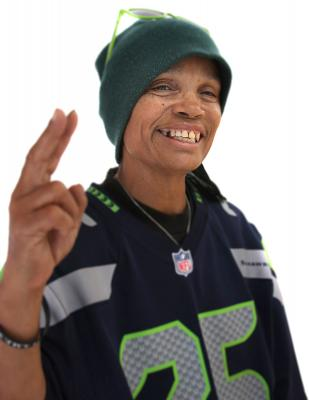 Real Change vendor Sharon Jones was passionate about the Seattle Seahawks. Photo by Jon Williams.