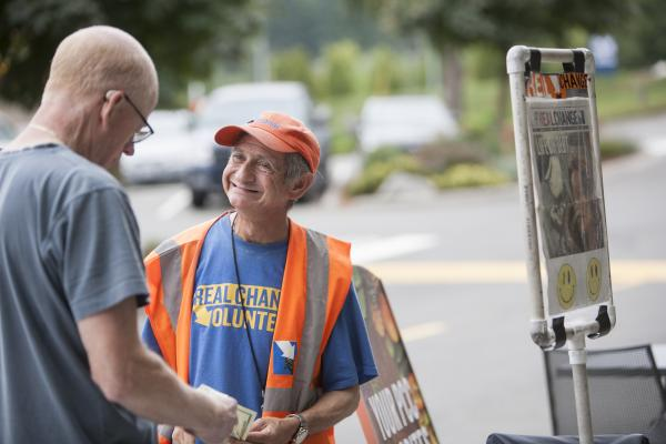 Shelly Cohen, 2016 Vendor of the Year, sells Real Change outside PCC in Bothell.