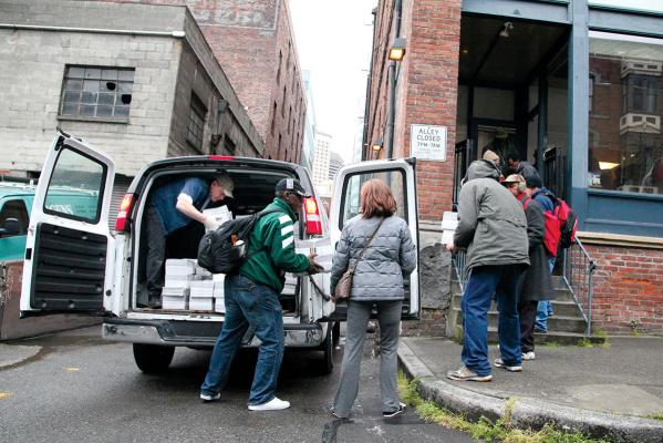 Every Wednesday, a van packing more than 10,000 copies of Real Change arrives at 96 S Main St. Photo by Rich Mealey
