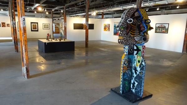 """The """"Truth B Told"""" group art exhibition at the historic King Street Station. Jerry Quenton's """"Four Faces To The Wind"""" is one of many sculptures in the show. Photo by Lisa Edge"""