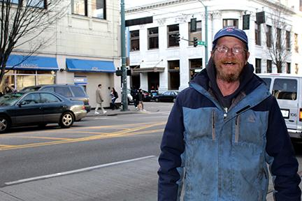 Michael Betcher, a man experiencing homelessness, has lived in the U District for the past two years and has expressed frustration over a lack of accessible housing. Photo by Amy Wong