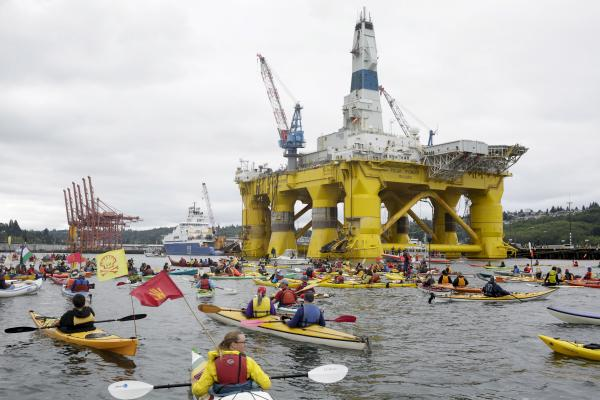 Activists protest the Shell Oil Company's drilling rig Polar Pioneer which is parked at Terminal 5 at  the Port of Seattle