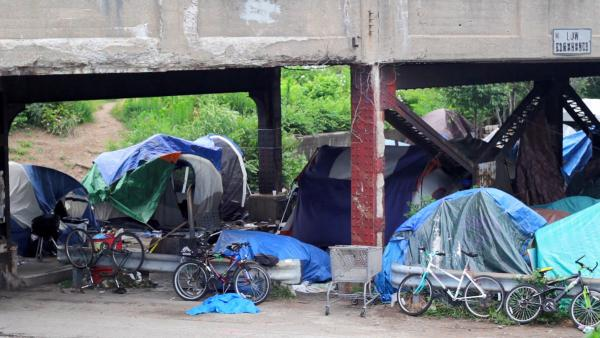 """Davidson Street Bridge homeless camp near downtown Indianapolis, Indiana, in 2013. Photo courtesy of """"Under the Bridge"""" filmmakers"""