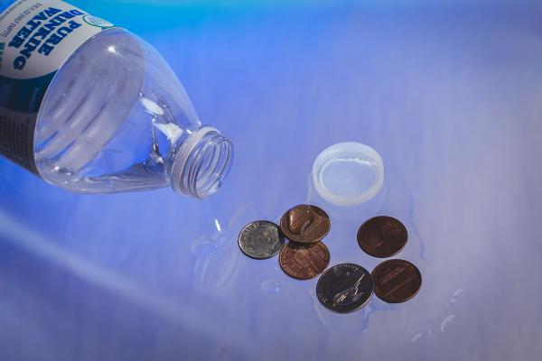 Like the soda tax, Washington's bottled water tax, which began in August, may unfairly impact low-income people. Photo illustration by Matthew S. Browning