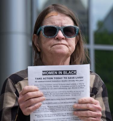 Diana Armstrong stands vigil outside the Seattle Municipal Court for the 42 homeless deaths that have occurred so far in 2018. Photo by Alex Bergstrom