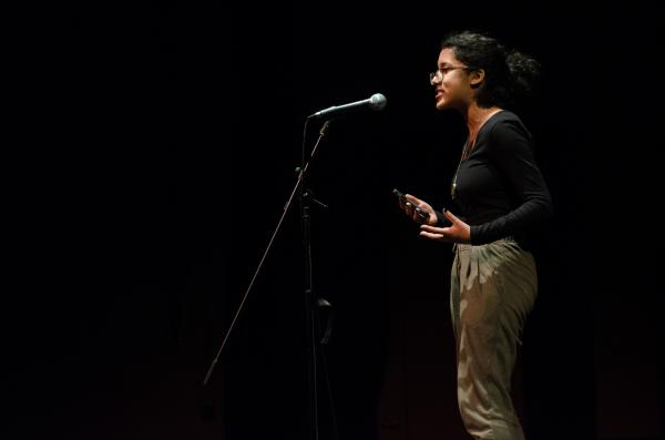 Azura Tyabji performing at Youngstown Cultural Arts Preliminary Slam in December 2015. It was her very first poetry slam, and she won, qualifying her for the 2016 Grand Slam event on April 1.