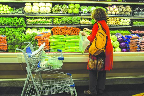Real Change contributor Susan Storer Clark shops for ingredients at the Kress IGA on Third Avenue downtown.