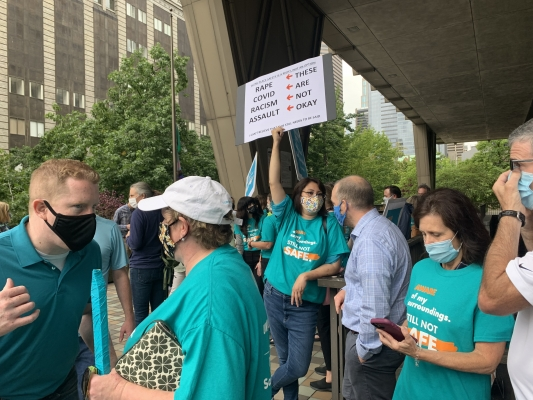 King County employees gather outside the courthouse downtown to protest for safer public spaces,