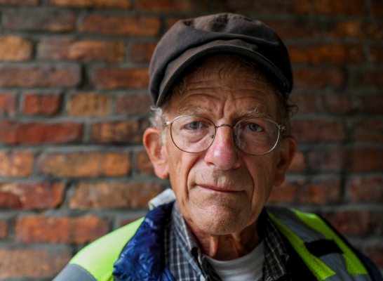 Real Change Vendor Kenneth Gutman worked hard to find a job that he could physically do and that also pays the rent. Selling the street paper helps him afford his apartment in the University District