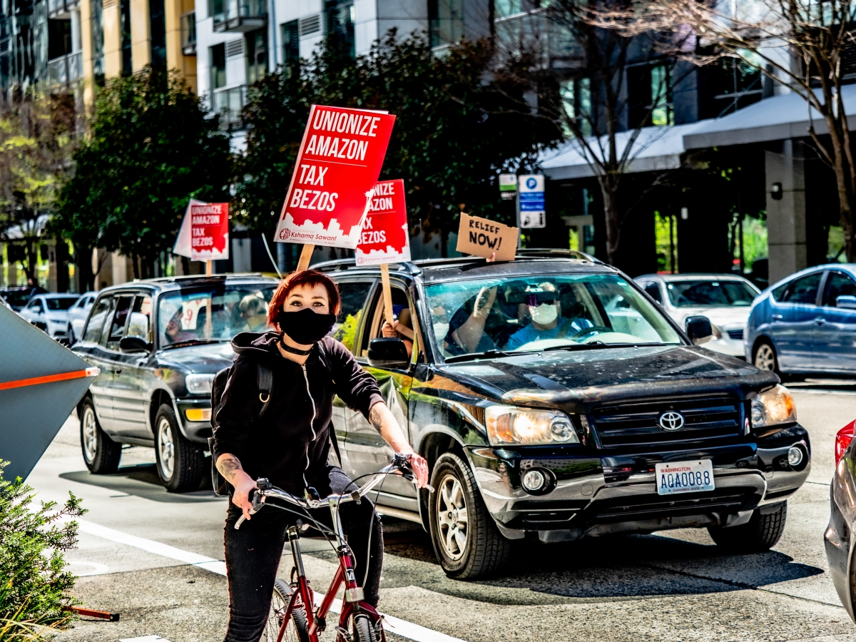 Protesters circled the spheres for an hour before caravaning to Seattle's Eastlake neighborhood, where the advocacy for a tax on big businesses continued with Kshama Sawant. The tax is meant to pay for low-income housing and Seattle's Green New Deal.